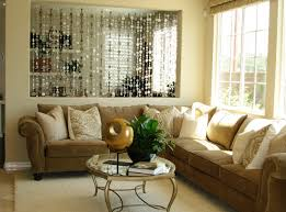 neutral living room decor the renovated dining room is illuminated with a metal chandelier and