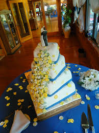 4 tier yellow and white flowers offset square wedding cake with