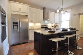updated kitchen white shaker cabinets and an espresso shaker updated kitchen white shaker cabinets and an espresso shaker cabinet island both with marble