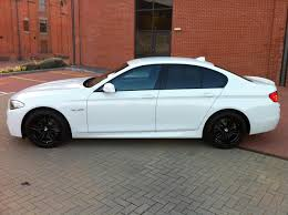 bmw black white car with black wheels does this look right