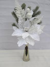 white poinsettia white christmas poinsettia in a silver bud vase