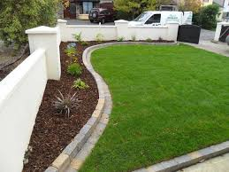 curving raised bed with mowing edge garden yards pinterest