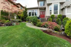frontyard garden of house with water fountain green grass lawn