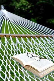 summer reading glasses and book on hammock marianne campolongo