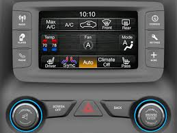 2014 jeep wrangler uconnect grand turn woodgrain background on touchscreen