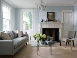 family room designs with fireplace soft blue wall color with grey couch for small family room