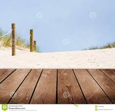 beach and empty wooden deck table royalty free stock images