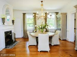 traditional dining room with high ceiling u0026 stone fireplace in