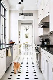 1346 best interiors kitchen design images on pinterest kitchen i think this might be it perfect white kitchen with black and white tile floors step inside a well balanced new york mansion painted floor