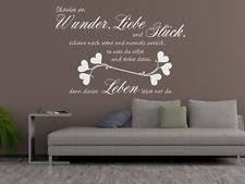 wandsprüche wohnzimmer wandtattoo wandsticker glaube an wunder liebe und glueck