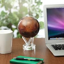 a solar powered mars spinning globe desk ornament