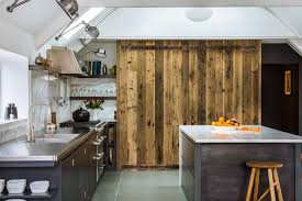 steel and marble kitchen with reclaimed feature sustainable