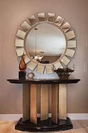 living room sunburst mirror in living room window treatments