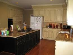 Distressed Black Kitchen Cabinets by Glazing And Distressing Black Cabinets Home Interiors