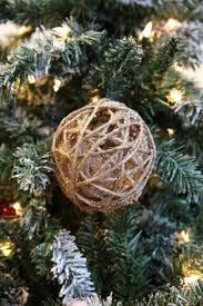 this lot of 6 primitive ornament snow