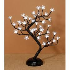 lighted tree with flowers knot and nest designs
