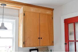 update flat kitchen cabinet doors 25 days of pinched kitchen makeovers day 11 add trim