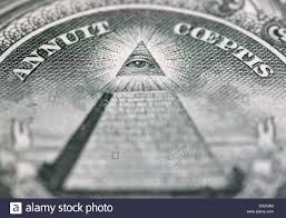 close up of eye of providence on one hundred dollars banknote