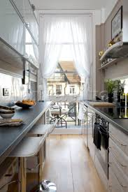 narrow galley kitchen parallel benches appliances centered