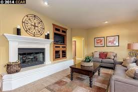 Travertine Fireplace Tile by Traditional Living Room With Built In Bookshelf U0026 Travertine Tile