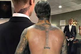 tattoo angel wings on neck justin bieber gets david beckham tattoo with angel wings on his neck