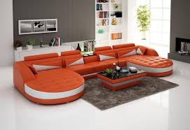 orange white double chaise sectional with curved tufted design and
