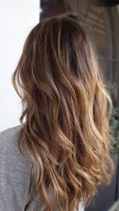 umbra hair picture of brown to caramel and blond ombre hair
