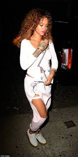 rihanna goes braless as she heads to tattoo parlor in new york