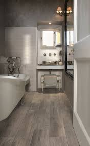bathroom tiling ideas pictures small bathroom with trendy faux wood flooring ideas hupehome