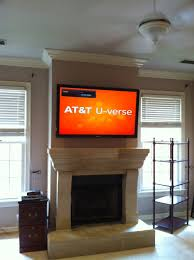 antique tv mounted over fireplace plus tv installations unisen a llc in tv above fireplace