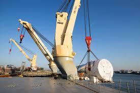 The Ship U0027s Onboard Crane Loads The Heavy Cargo Siemens Global
