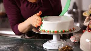 Christmas Cake Decorations Images by How To Attach Decorations To A Christmas Cake Howcast The Best