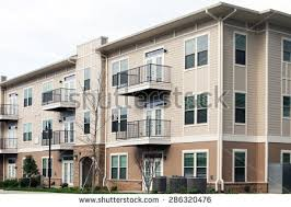 3 story building modern 3 story apartment condominium building stock photo