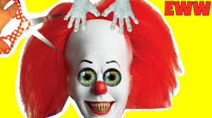 cutting open squishy clown head scary it clown movie mask blind