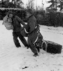 siege air 101st airborne division troops retrieving air dropped supplies