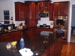 Granite Countertops With Cherry Cabinets Cherry Kitchen Cabinets Black Granite