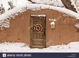 a traditional door on an adobe style home in the arroyo tierra