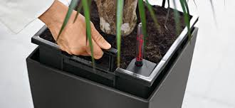 self watering indoor planters how to water indoor plants while you re away groomed home