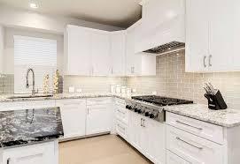 white shaker kitchen cabinets backsplash white shaker kitchen cabinets with gray glass tiles