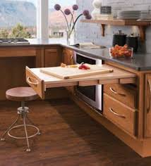 cabinet with pull out table kraftmaid passport series pull out table makes it easy to sit down