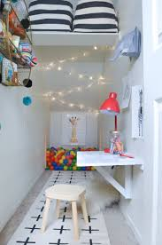 the big reveal under the stairs play closet playrooms modern