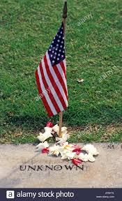 Flags In Hawaii Plumeria Lei Encircles American Flag Marking Grave Of An Unknown