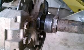 rear axle lock nuts is this right honda atv forum