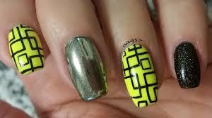 neon yellow silver chrome and holo black glitter nail design