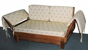 a heals oak day bed by parker knoll with later fabric cushions