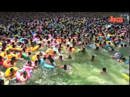 the most crowded swimming pool in the world youtube