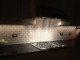grouting kitchen backsplash 2x4 white subway tile gray grout xenon cabinet