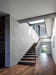 a home of glass and concrete with canyon views stairs