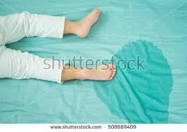 peeing the bed kids feet pee mattresslittle girl feet stock photo 508689409