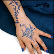 blue henna tattoo for women hand drawn style finger tattoo